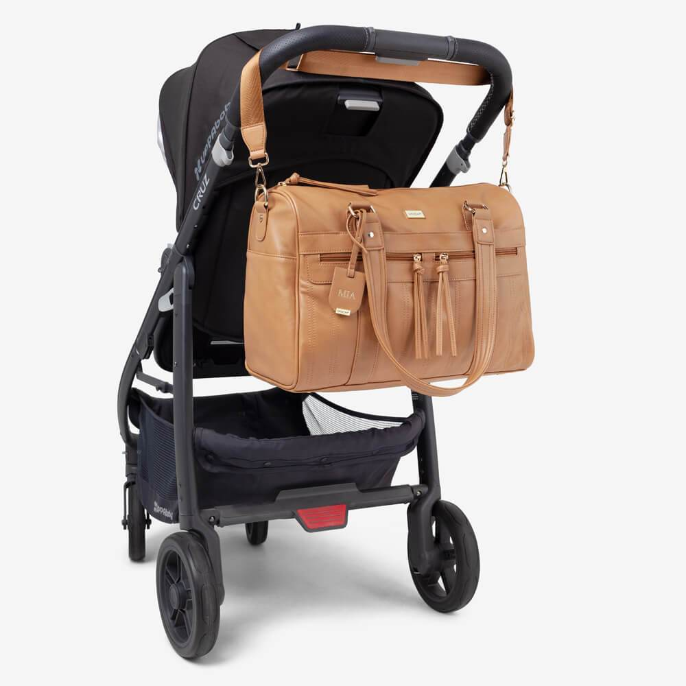 Vanchi Indie Holdall Angle Camel On Pram 2